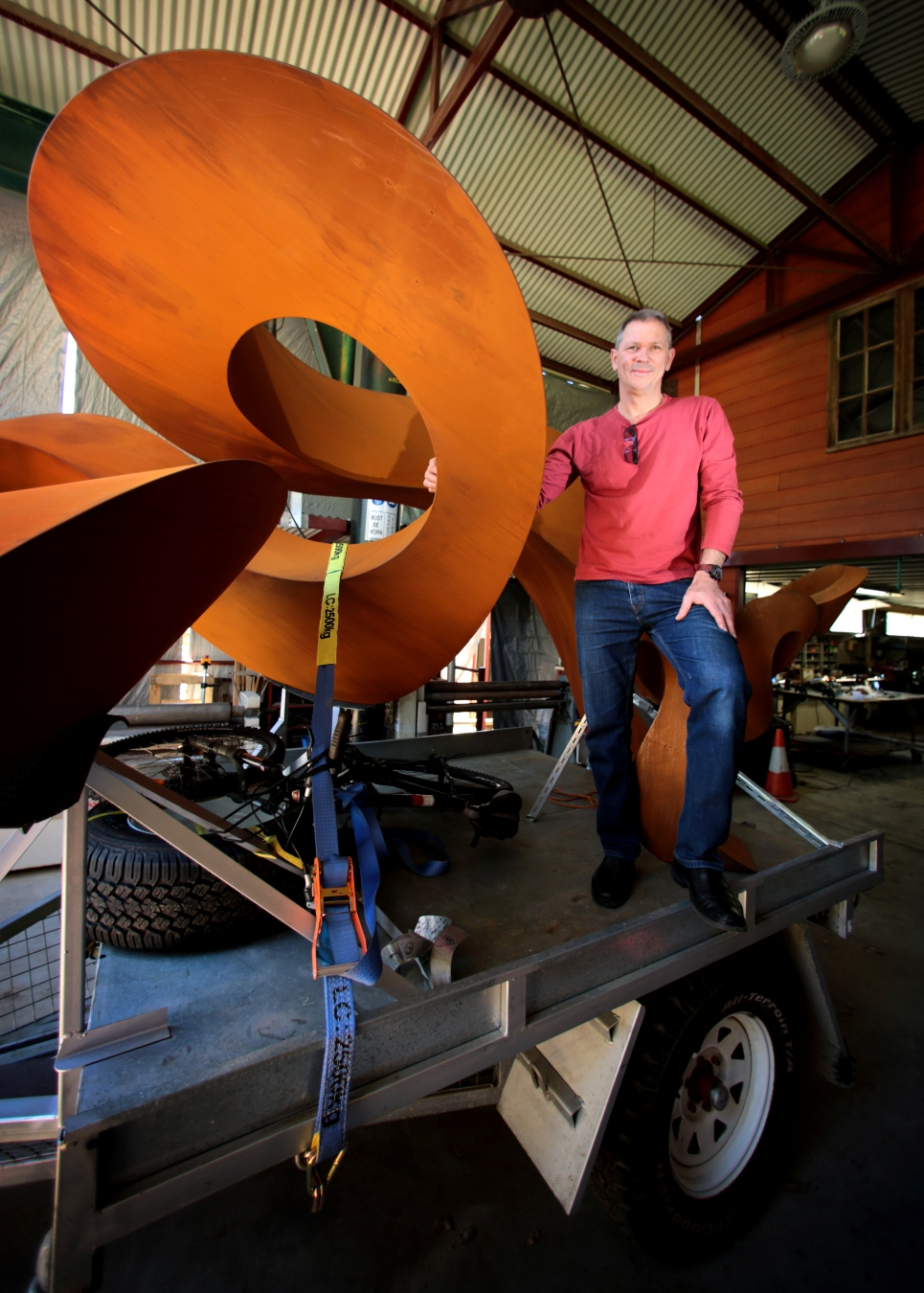 Johannes Pannekoek, of Gooseberry Hill, stands next to his sculpture, Change Ahead, loaded on a trailer ready for the trip across the Nullabor. Picture: David Baylis