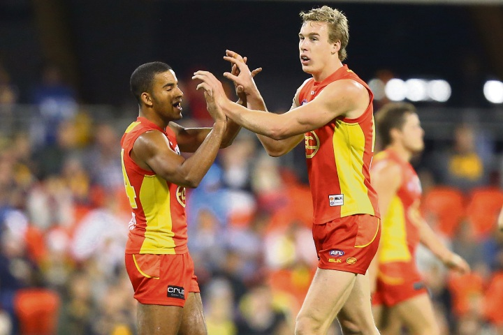 Tom Lynch, right, kicked a goal with the last play of the game to earn a draw for Gold Coast Suns against the West Coast Eagles on the weekend.