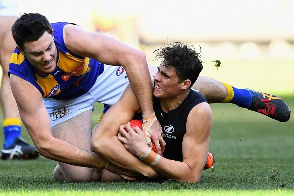 Jeremy McGovern battles with Charlie Curnow in West Coast's win over Carlton. Picture: Getty Images