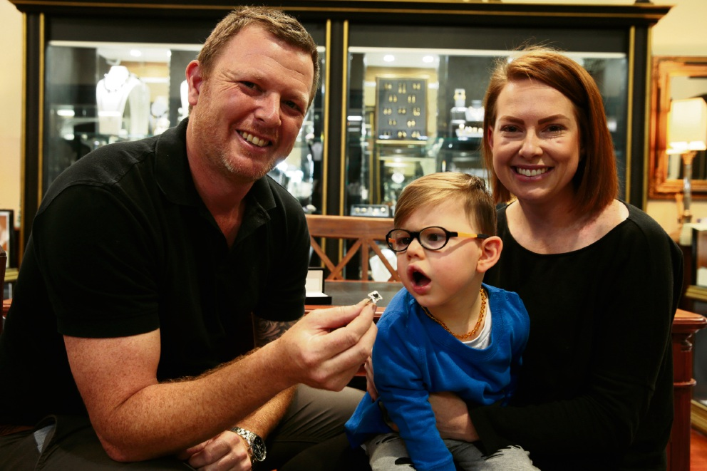 Jeweller Scott Broadley with Owen DiCandilo  and mum Taryn DiCandilo with the piece of jewellery that will be auctioned for charity from the House of Riches. Picture: Andrew Ritchie