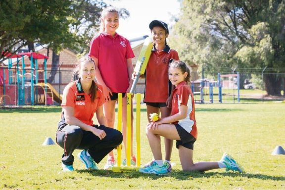 Perth Scorchers bowler Piepa Cleary with Caralee Community School students Jade Halliday, Romanika Noun and Kaylen Caruana.