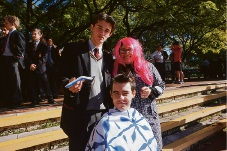 Aquinas College Year 11 student James Caspersz-Loney is ready to give student Year 12 Jack Gorman a haircut while pastoral care deputy principal Paula Bacchiella looks on.