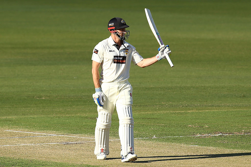 Shaun Marsh of the Warriors raises his bat after reaching his half century during day one of the Sheffield Shield match between Western Australia and South Australia at WACA yesterday.  Picture: Paul Kane/Getty Images