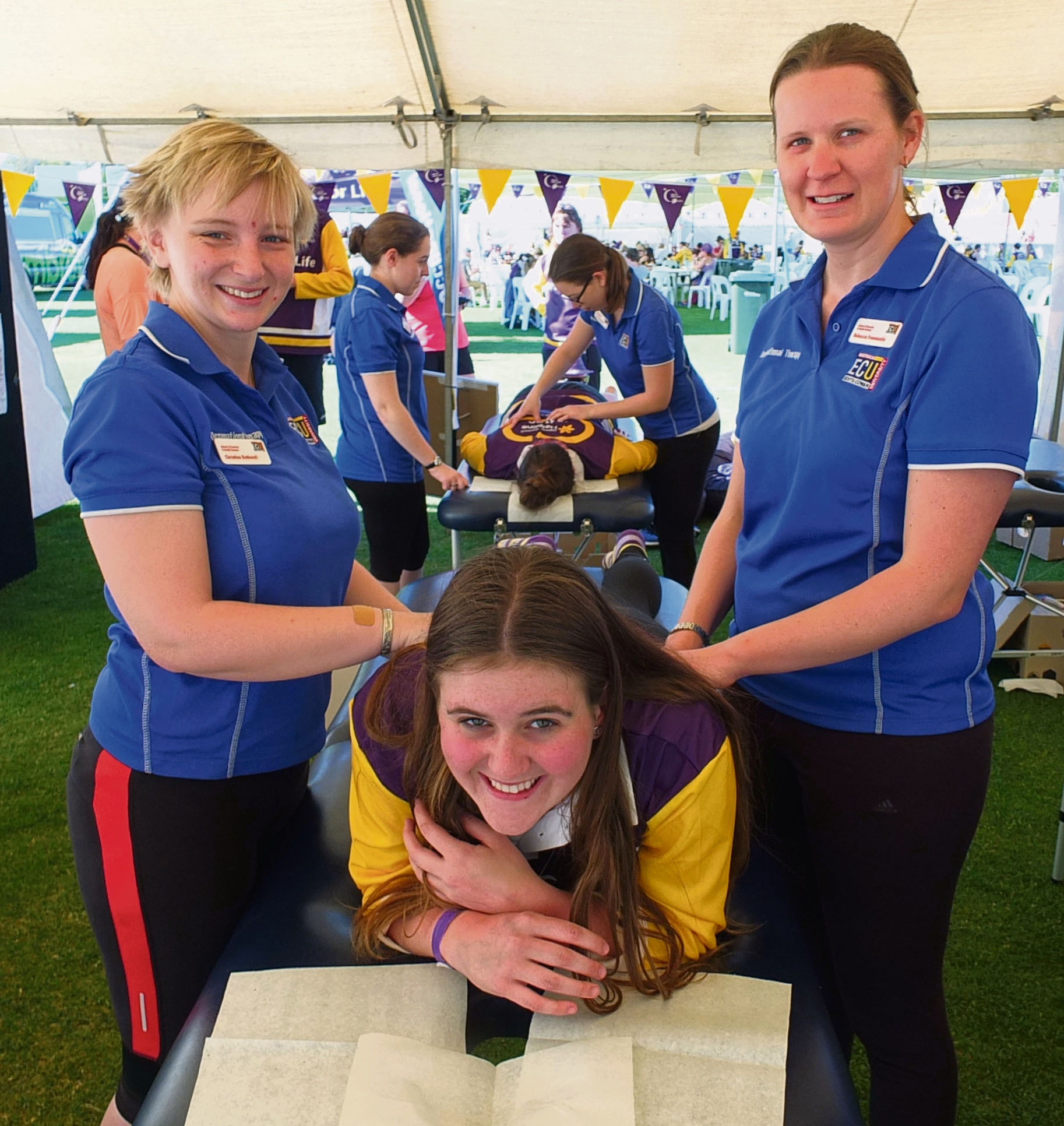 ECU Third Year Occupational therapists Christina Bothwell and Rebecca Freemantle prepare to massage Grainne Hamill.