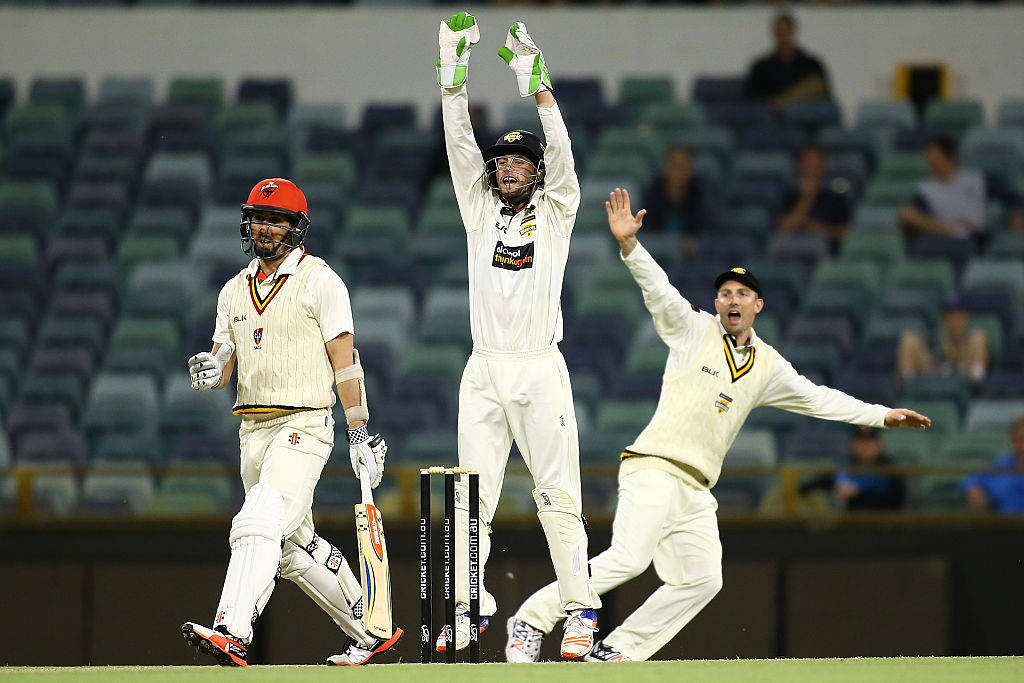 Sam Whiteman and Shaun Marsh appeal unsuccessfully for the wicket of centurion Tom Cooper . Picture: Paul Kane/Getty Images