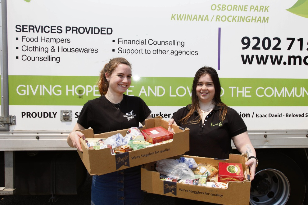 Britts Twiss and  Tanisha Angeleri help the foundation to feed those in need.