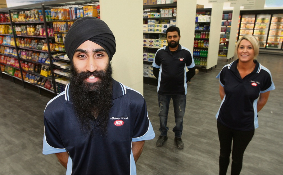 Sahib Singh, Chetan Patel and Jessica McManus at the new IGA store in Alkimos. Picture: Bruce Hunt        d461031