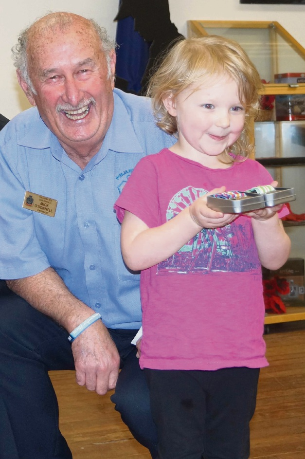 Mick O'Donnell with Peyton Downs and her medallion.