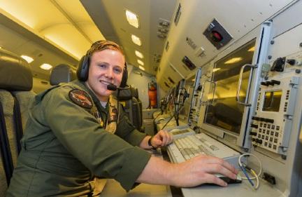 Flt Lt Mark Swinn, from Port Kennedy, at the sensor panel of an E-7A Wedgetail aircraft.