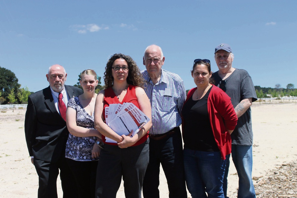 Residents Richard Palmer, Labor candidate Jessica Young, Jessica Shaw, Gavan Troy, Shayna Nichols and Gunther Robl.