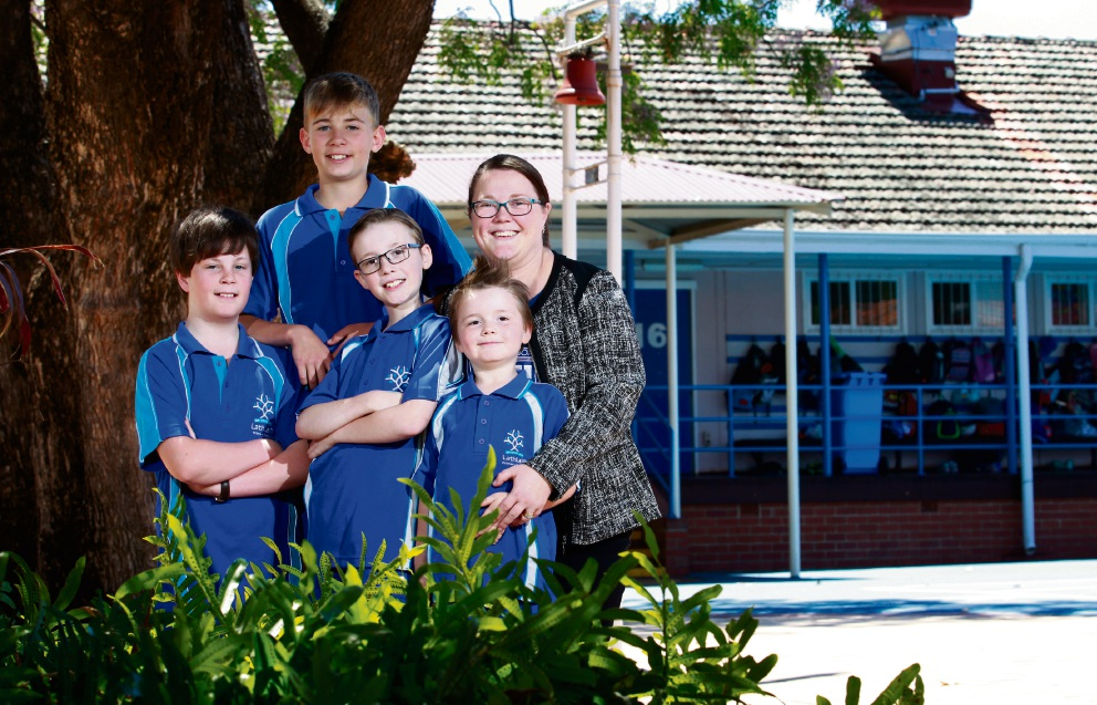 Sarah McLachlan, who went to Lathlain Primary School, with two of her three children Byron (glasses, 10) and Jarrad (5), and Solomon Lindsay (12, at left) and Will Turner (12, back). Picture: Marie Nirme