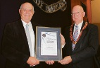 Worksafe Commissioner Lex McCulloch presents the Platinum Worksafe Award to Belmont Mayor Phil Marks.