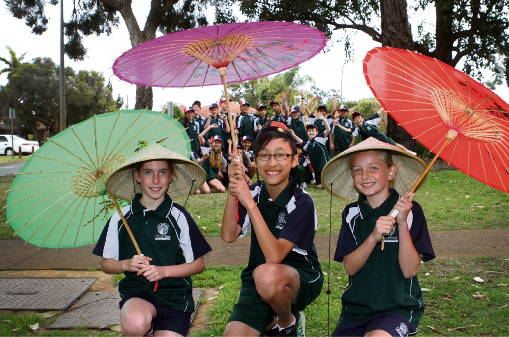 China bound: Brooke McKenzie, Victor Gan and Phoenix Waugh (front) with year 5 and 6 students. Picture: Robin Kornet        www.communitypix.com.au   d459232