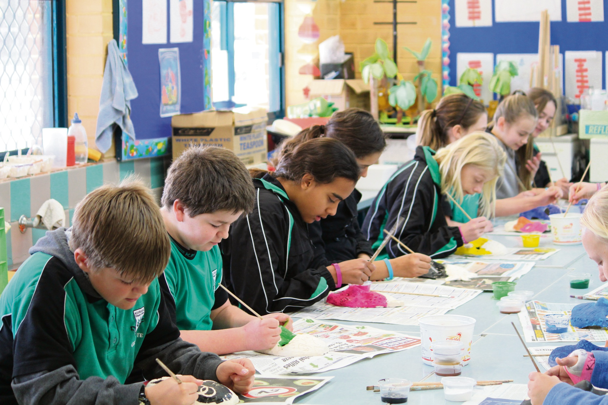 Year six student's work hard on their masks at Koorana Primary School during art class.