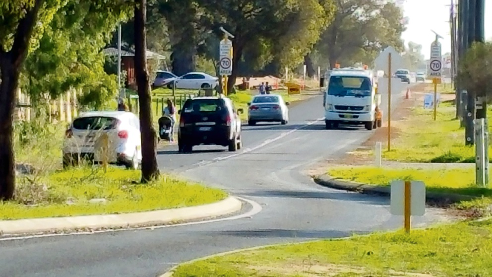 Students and parents at Caversham Primary School share the 70km/h road with cars.