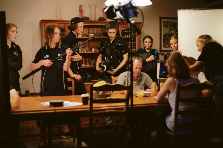 Writer and cinematographer Ben Clarke and crew record a scene for their movie, Evie.