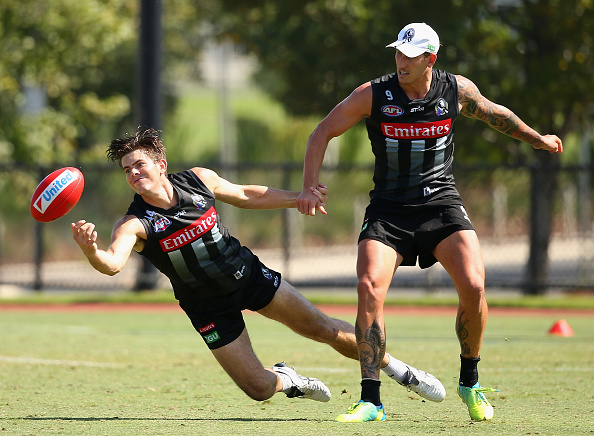 Corey Gault, left, at a Collingwood Magpies training session in March 2016. Picture: Getty Images.