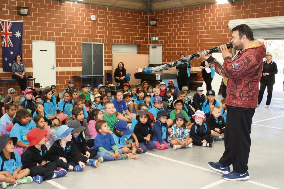Phil Walleystack performing for Avonvale Primary School students on his didgeridoo.