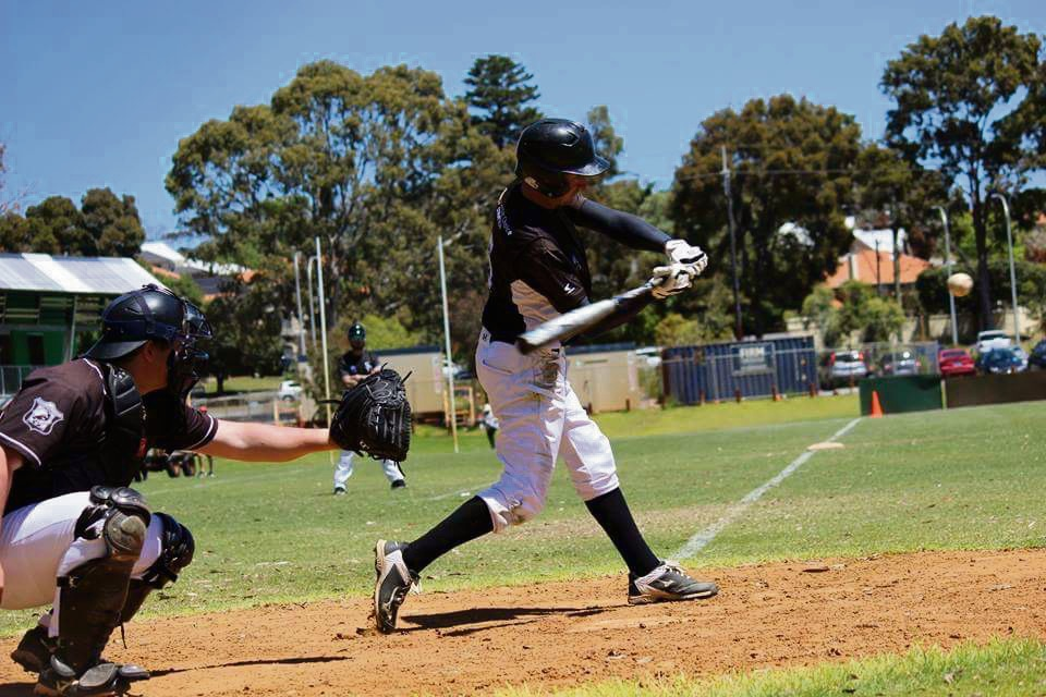 Swan Districts president Rob Daniele hits a home run.