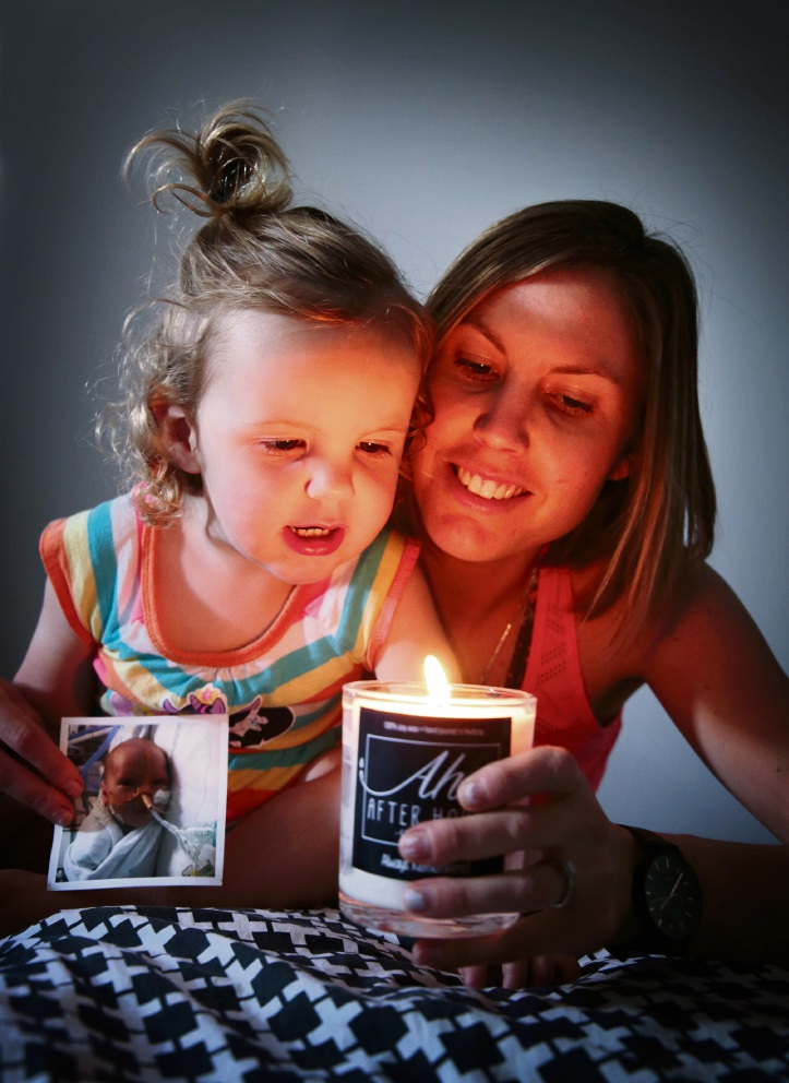 Leisha Clarkson and Maya lighting a candle for Brodie. Pictures: David Baylis In training for the walk.         d461224