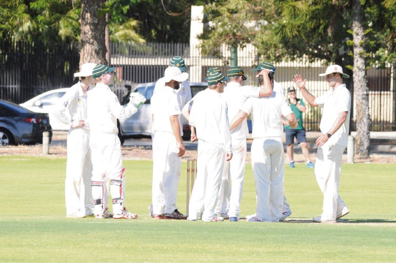 Scarborough players celebrate their upset win over South Perth.