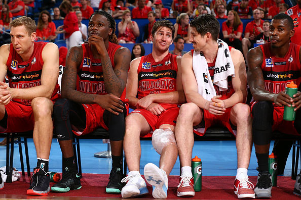 Damian Martin (centre) ices his left knee during the Wildcats round five NBL win over Adelaide 36ers.  Picture: Paul Kane/Getty Images