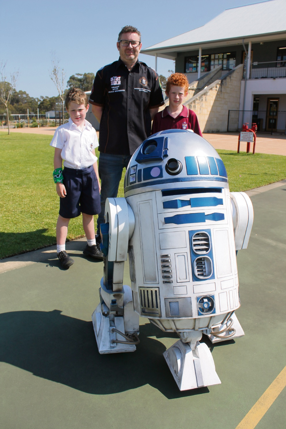 James, Grant and Matthew Thomson with their R2D2 at Peter Carnley Anglican Community School last week.