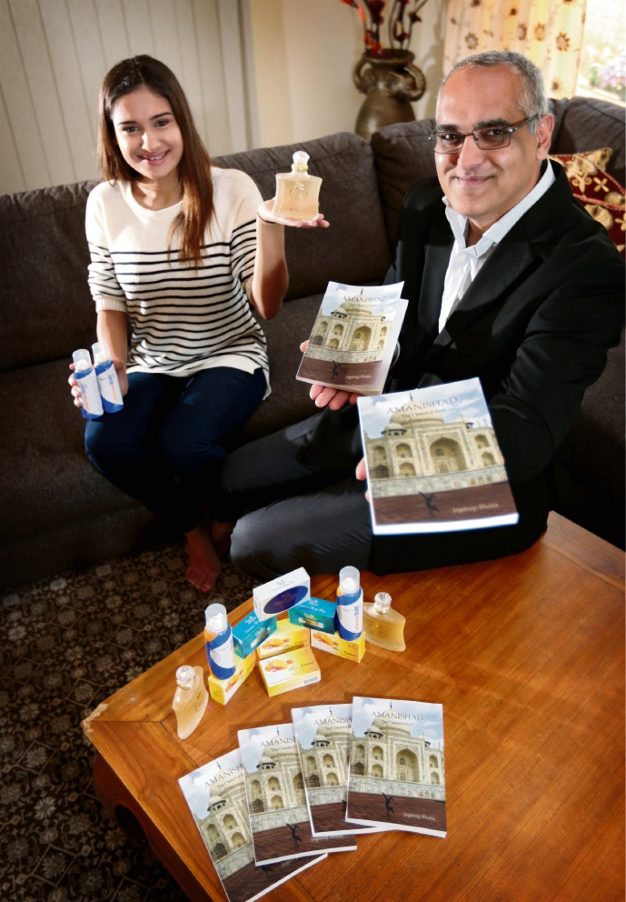 Jagdeep Bhatia (right) who has published a book recently called Amanishad - The Cheerful Soul and who owns La Reine Perfumes with his daughter Yashoda Bhatia (14). Picture: David Baylis