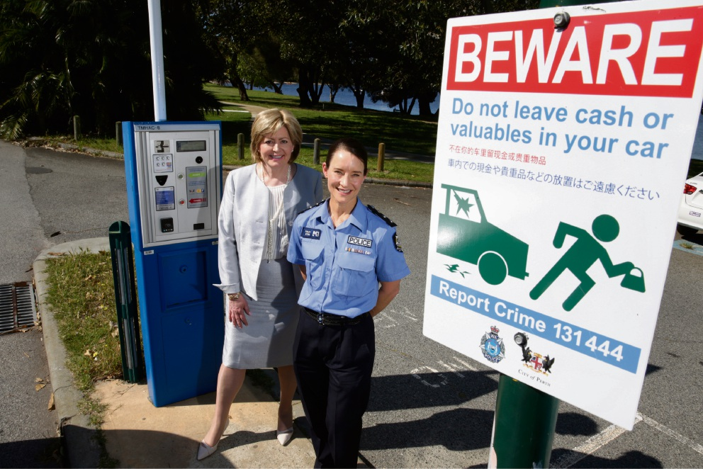 Perth Lord Mayor Lisa Scaffidi with Acting Inspector Julie Foley install the first ever multi-language signs warning tourists of crime hotspots. Picture: Andrew Ritchie