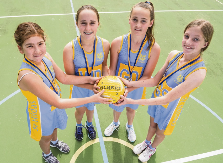 Netballers from St Hilda's have had back-to-back wins in an unforgettable season. Left to right Alyssa Warren (Year 5), Ava Renouf (Year 7), Charlotte Cox (Year 7) and Rebecca Andrawes (Year 6) after their respective team wins. Picture: Supplied