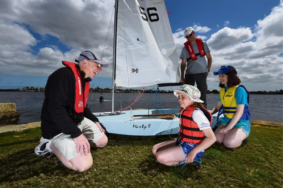 Shelley Sailing Club Commodore Alec Duncan with Elizabeth Abbott (7), Jon Abbott and Josie Duncan. Picture: Jon Hewson.