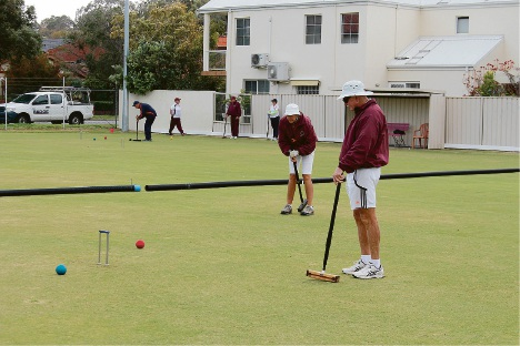 Queensland golf croquet players Rosemary Newsham and Peter Nicholson take to the field.