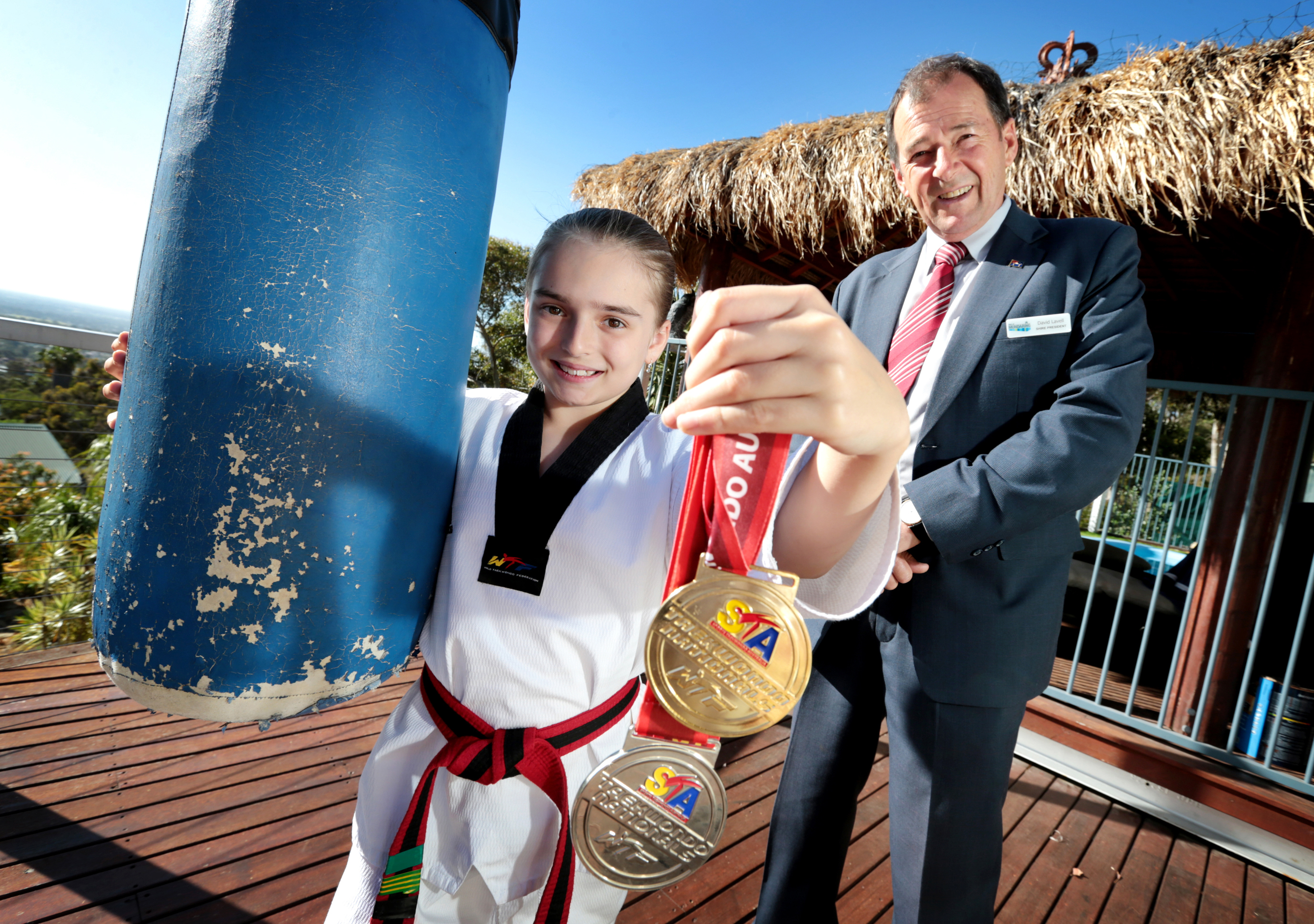 Shante Regnault (9), of Swan View, with Shire of Mundaring President David Lavell. Picture: David Baylis d461609
