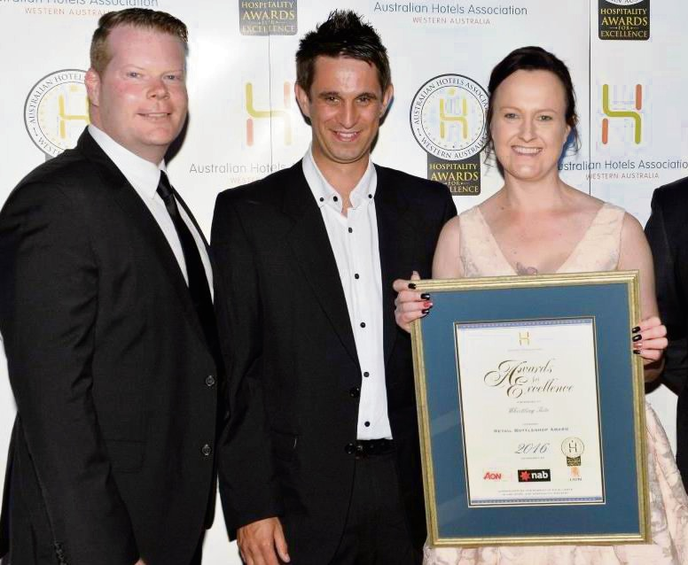 Whistling Kite staff David Tiley, Gary Drummond and Stacy Filmer accepting their award.