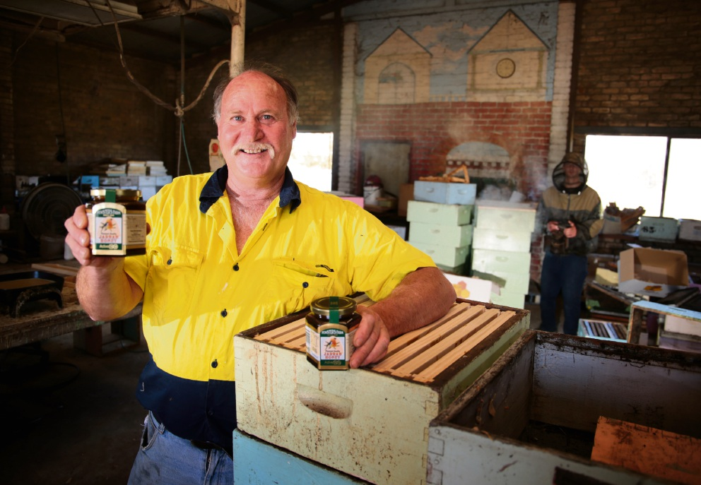 Fewster's Farm Kim Fewster with jars of his award-winning honey.   Picture: David Baylis         d461574