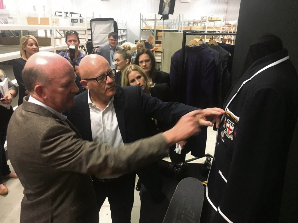 John Day with Heath Ledger's father Kim looking at Heath's school blazer.