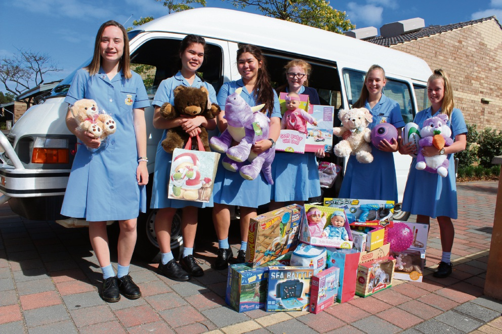 Aleah Dickson, Annie Koko, Hana Clark, Sinead Holmes, Teagan Robinson and Charlotte Spinks with some of the toys they collected for the Ronald McDonald House Christmas party.