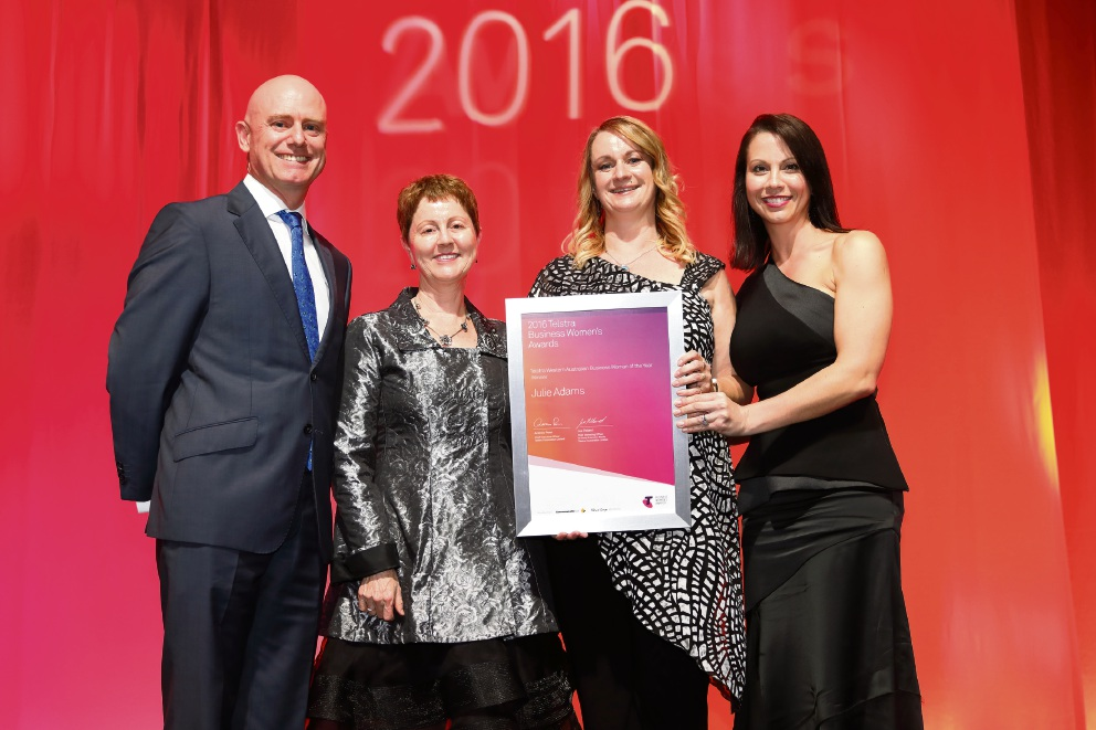 Minister for Small business Sean L'Estrange with last year's WA winner Angie Paskevicius congratulate Julie Adams with Telstra Regional Director Janet Barnes.