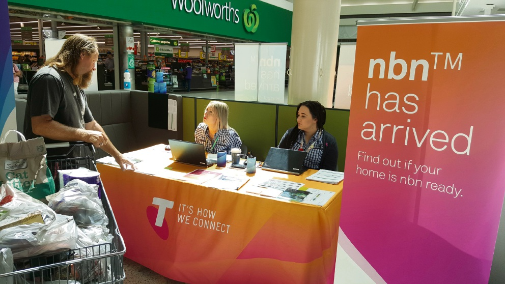 Telstra had an information stall at a shopping centre to help residents connect to NBN.