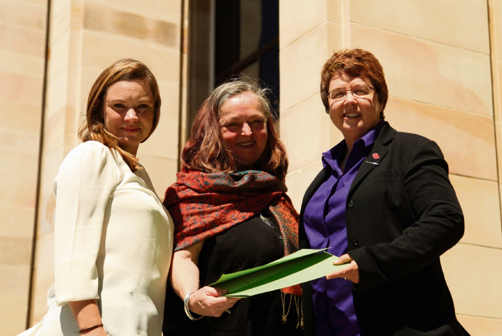 Greens candidate for Bassendean Sarah Quinton and local resident Kathryn Hamilton present the petition to Greens MLC Lynn MacLaren at Parliament House.