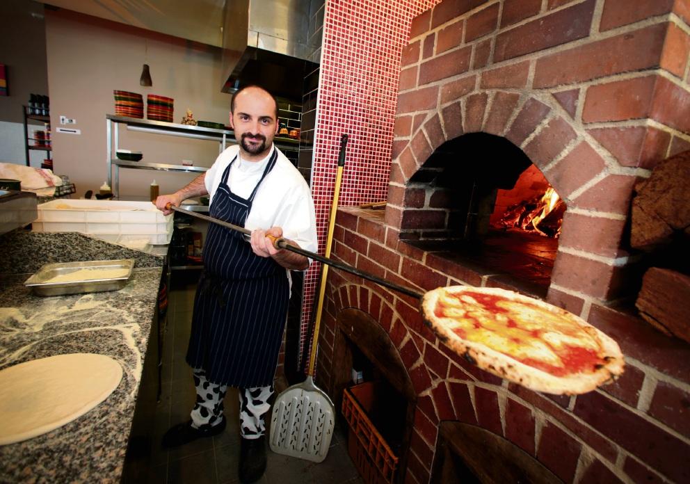 Lorenzo Schiaffini, owner of Woodfire Italian Restaurant, seen here with his bufala pizza. |Picture: David Baylis www.communitypix.com.au d461847