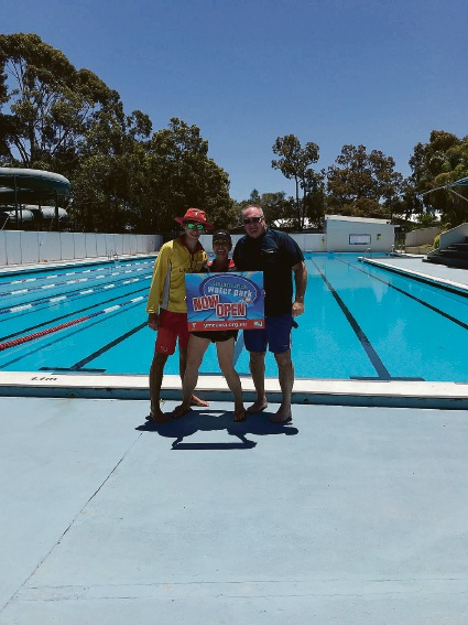 YMCA lifeguard Kieran Higgins, manager Natascha Siebert and the first customer of the season Reece Fenton.