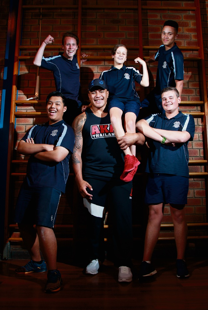 Soa 'the Hulk' Palelei with Southern River student Lachlan Baldock on his shoulder, Nathaniel Otte  and Chad Bruiners (back) and Nguyen Le and Corey Alexander (front). Picture: Marie Nirme        d462190