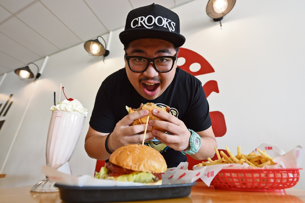 Johnny's Burger owner Johnny Wong likes to make good burgers and even better burger challenges. Picture: Jon Hewson d452531
