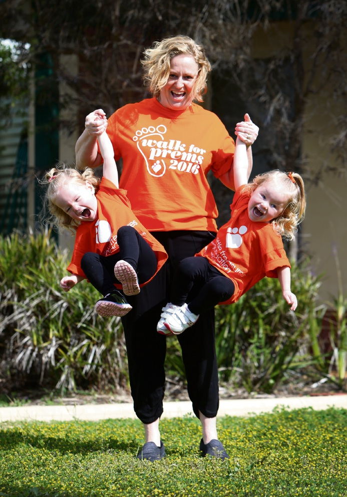 Two-and-a-half-year-old twins Emily (left) and Matilda (right) with mother Kaylene Shepherd. Picture: Matt Jelonek
