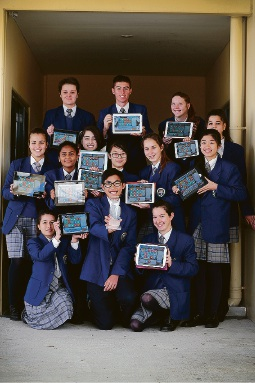 Hao Doan (centre holding trophy) with fellow Year 9 students who placed 2nd in Australia in the Wordmania Competition. Picture: Andrew Ritchie