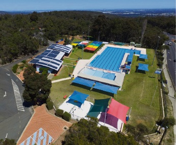 PHOTOGRAPHER Rhys Williams captured this aerial shot of the Shire of Mundaring's Bilgoman Aquatic Centre in time for the summer weather. The centre, on the corner of Lionel Road and Great Eastern Highway in Darlington, opens along with the Shire's other pools from October to April. Many locals recognise it is open for business when the 'Diving Girl' appears out the front.