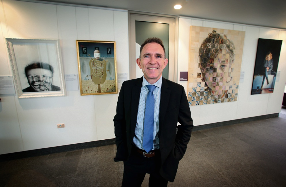 St John of God Midland Public and Private Hospital deputy chief executive Michael Hogan with some of the Black Swan shortlisted artworks on display in the hospital foyer.       d462205