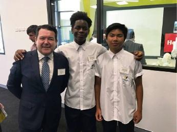 Dean Smith with students Martin Wachipa and Danuel Delleva.