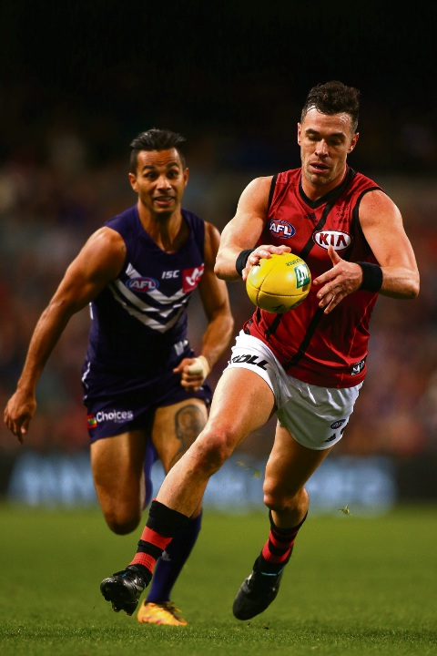 Ryan Crowley kicks for Essendon against the Dockers in 2016. Picture: Paul Kane/Getty Images